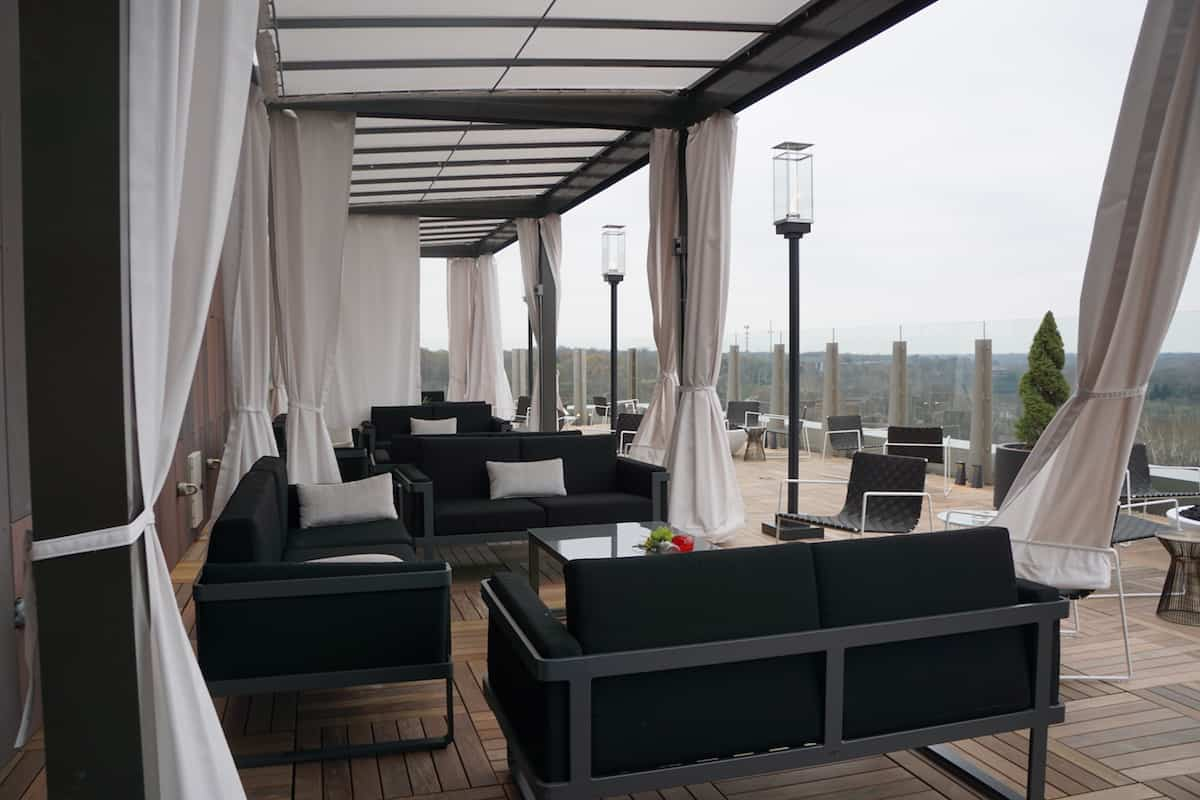 Enjoy tapas and drinks in a private cabana on the outside patio of VASO Rooftop Lounge. | Where to eat in Columbus, Ohio | Spanish food | AC Hotel Columbus Dublin | TravelingWellForLess.com