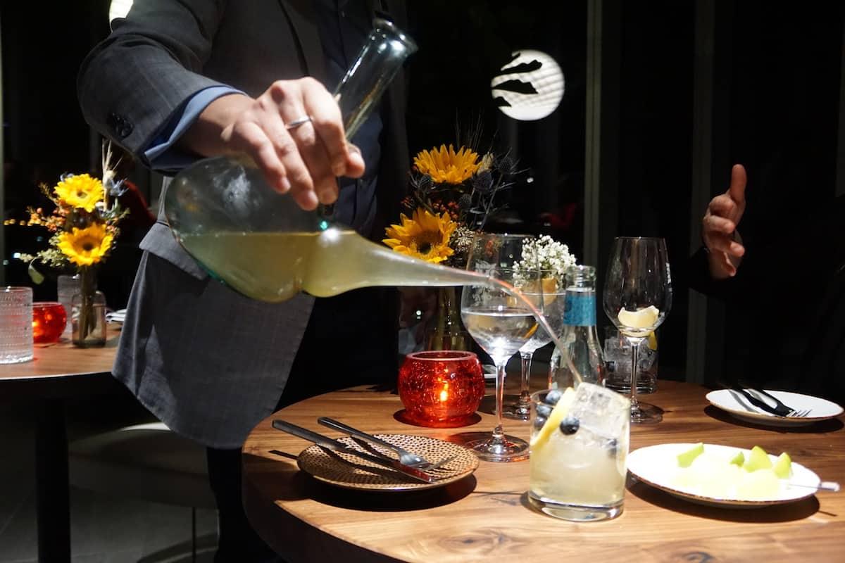 Vaso Rooftop lounge porron in action. | Dublin, Ohio | Columbus | Spanish food | where to eat in Columbus | TravelingWellForLess.com
