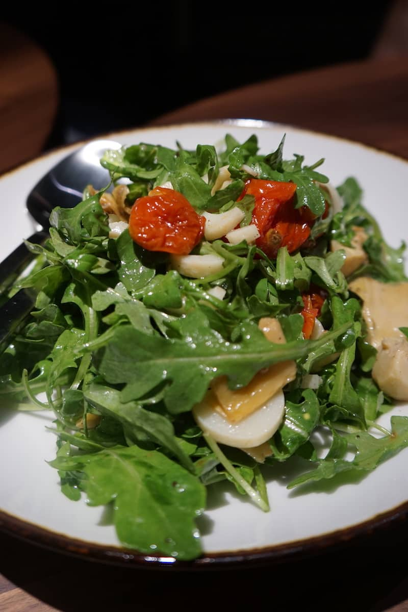 roasted artichoke salad with hearts of palm and sun-dried tomatoes and lots of arugula was sublime. | Dublin, Ohio | Columbus | Spanish food | where to eat in Columbus | TravelingWellForLess.com