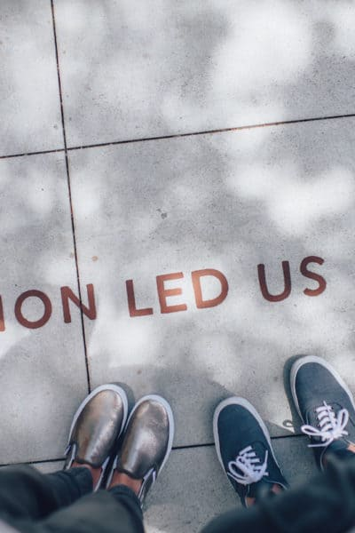 the words passion led us here on a sidewalk