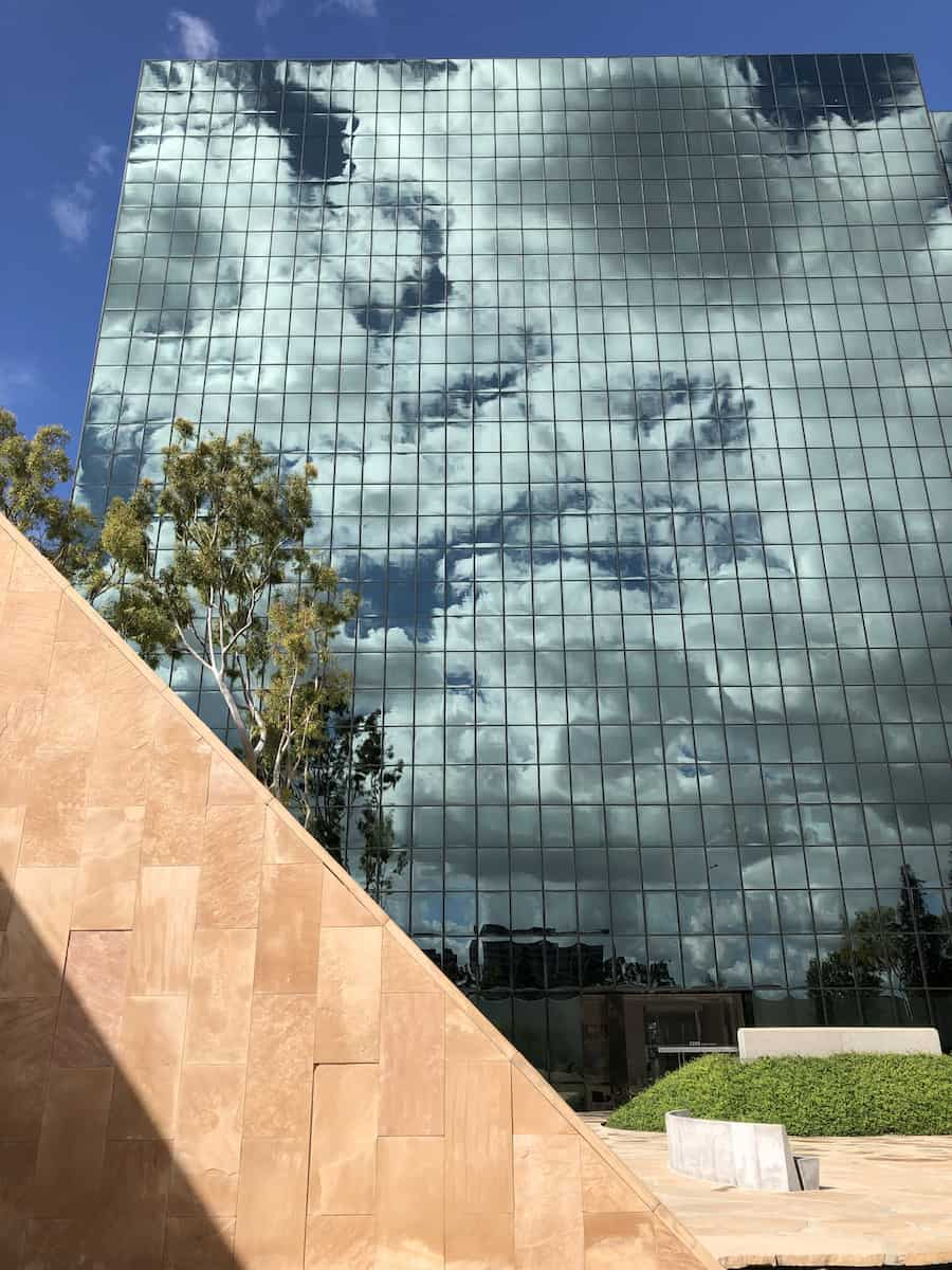 Clouds reflected in mirrored building surrounding Noguchi Garden, best things to do in Costa Mesa