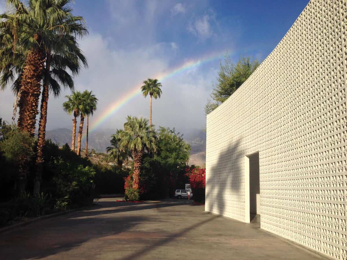 rainbow in sky over parker palm springs front entrance