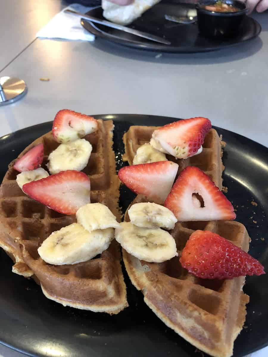 St Clair waffle with strawberries and bananas, Rooster Cafe, best things to do in Costa Mesa