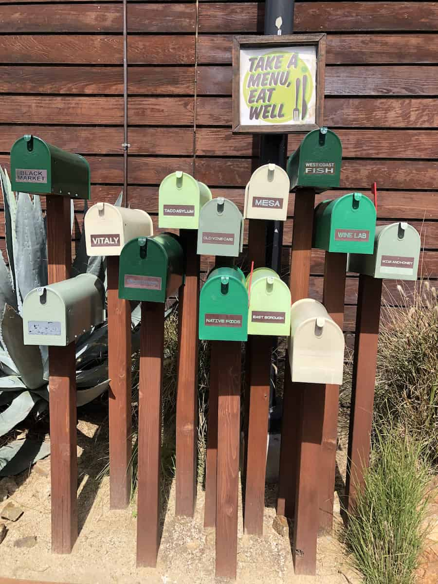 Mailboxes of menus for The Camp restaurants, one of the best things to do in Costa Mesa