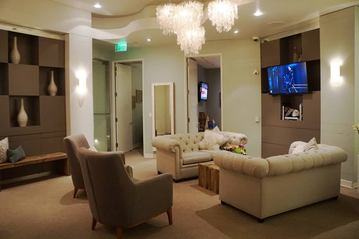 couches and chairs in the VIP Access Lounge in South Coast Plaza, one of the best things to do in Costa Mesa