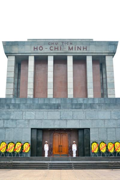 two guards and flower wreaths at front of Ho Chi Minh Mausoleum