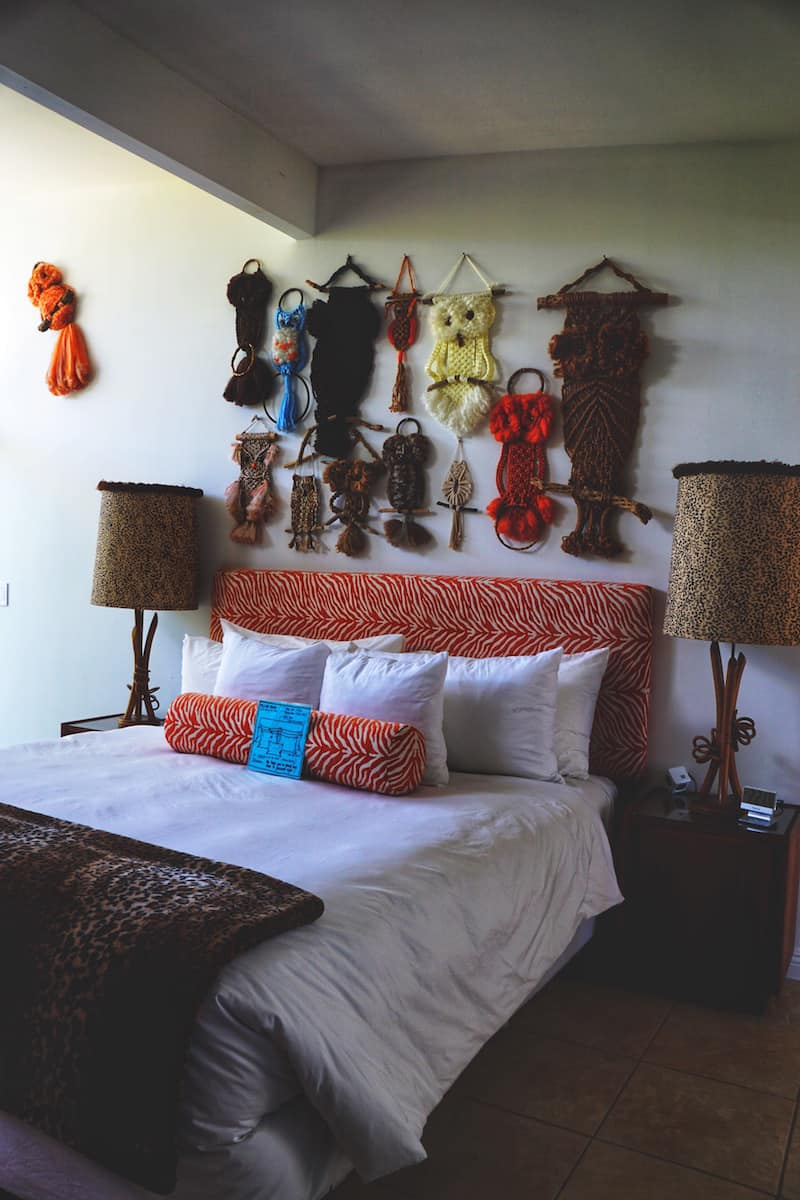 owl macrame above bed
