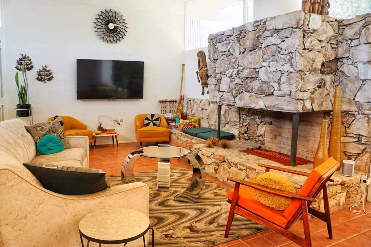 Mid-century couch, chairs, fireplace