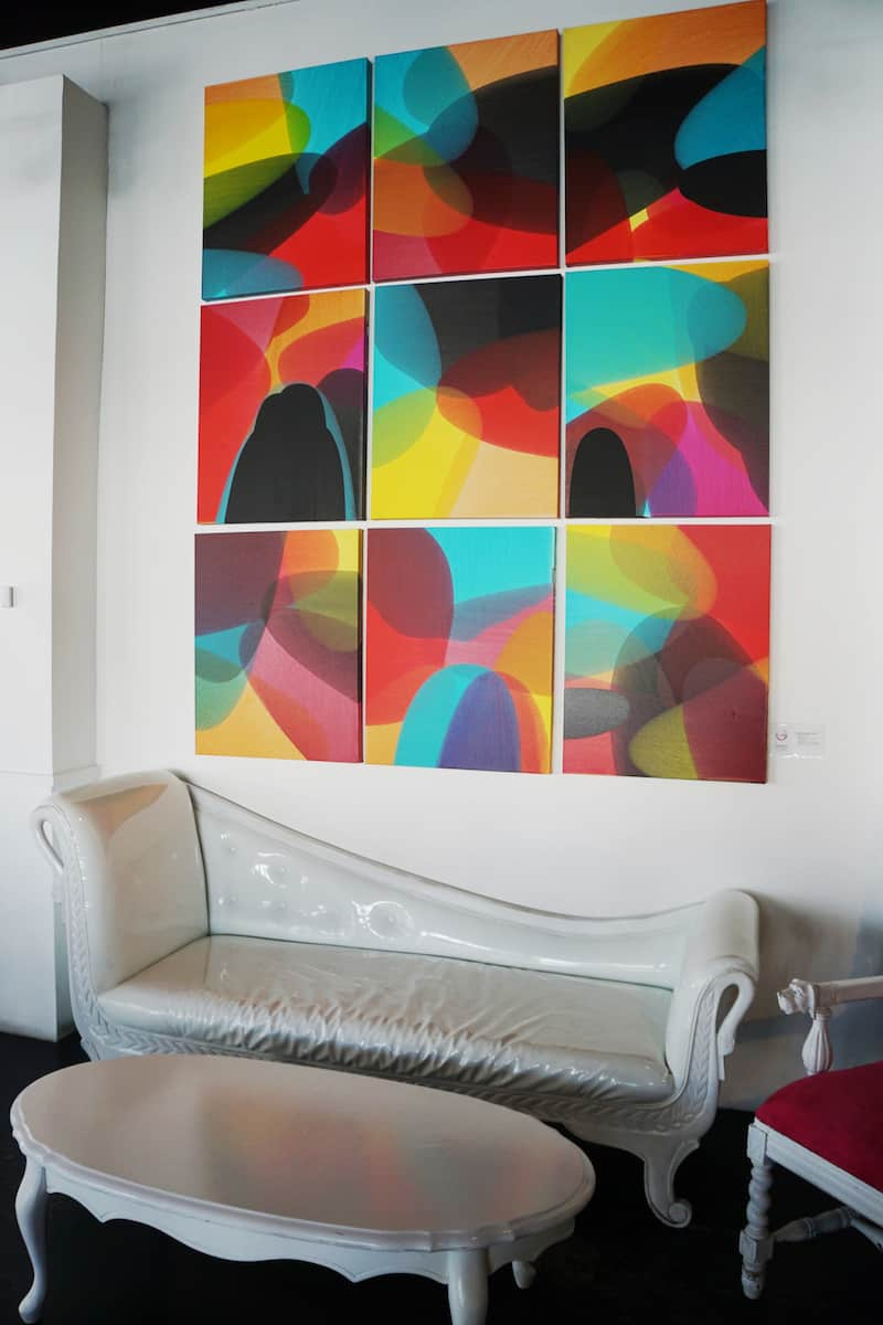 colorful artwork at chic restaurant with white furniture