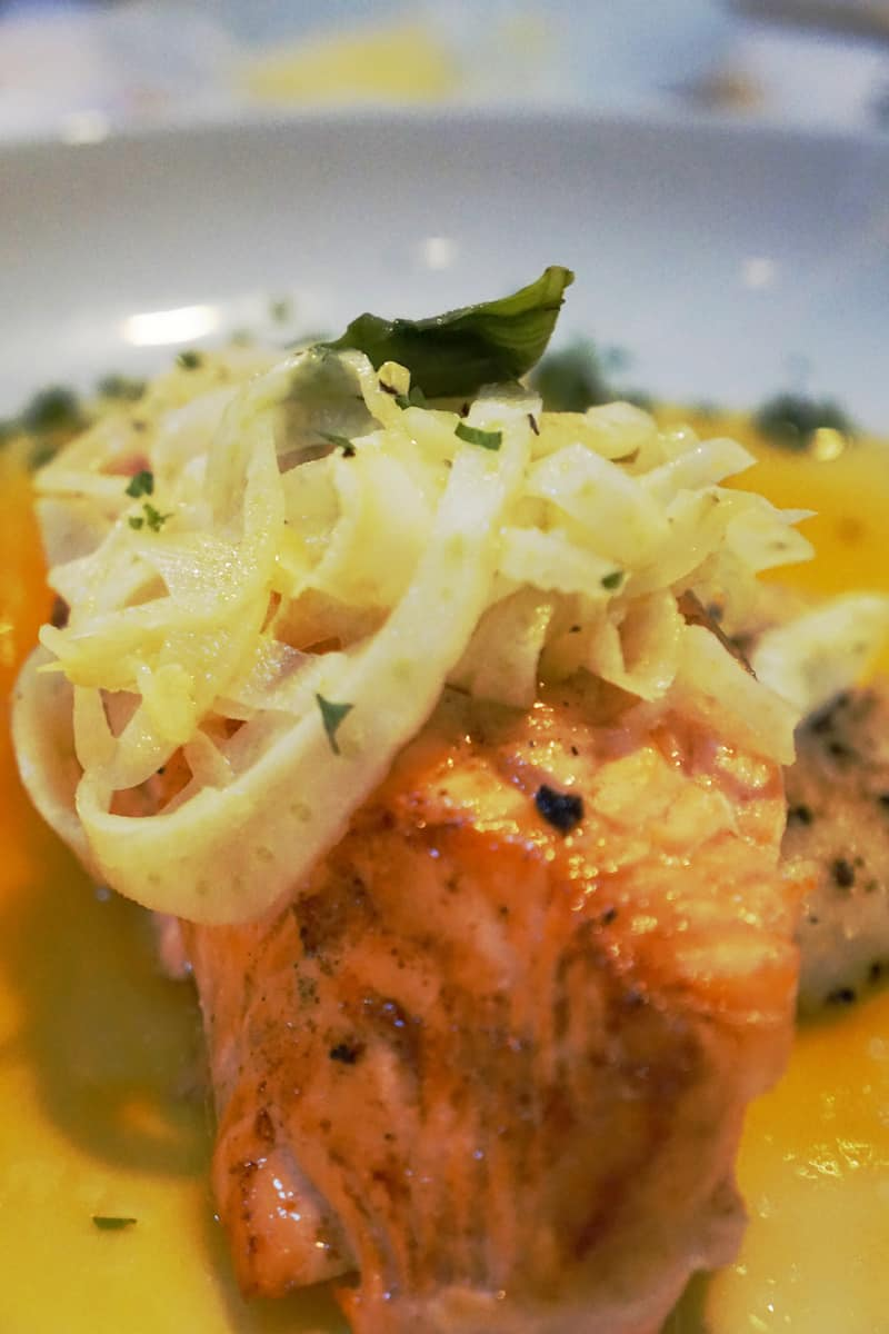 steelhead trout entree topped with fennel in orange sauce
