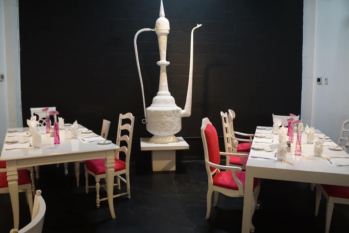 giant hookah in chic restaurant with white furniture