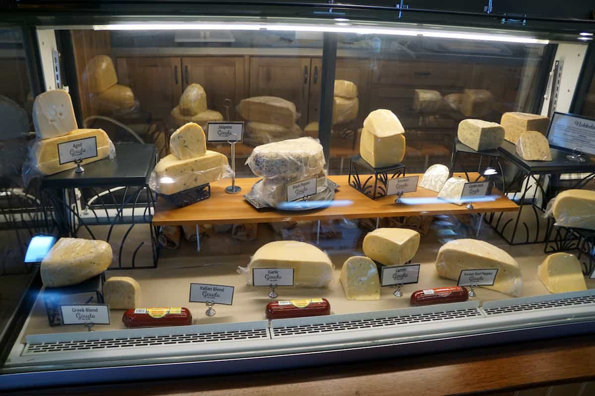 A refrigerated display of 11 types of gouda cheese at Appel Farms. If you love cheese, one of the best things to do in Lynden is a trip to Appel Farms. #cheese #gouda #thingstodoinLynden #Lynden #Washington