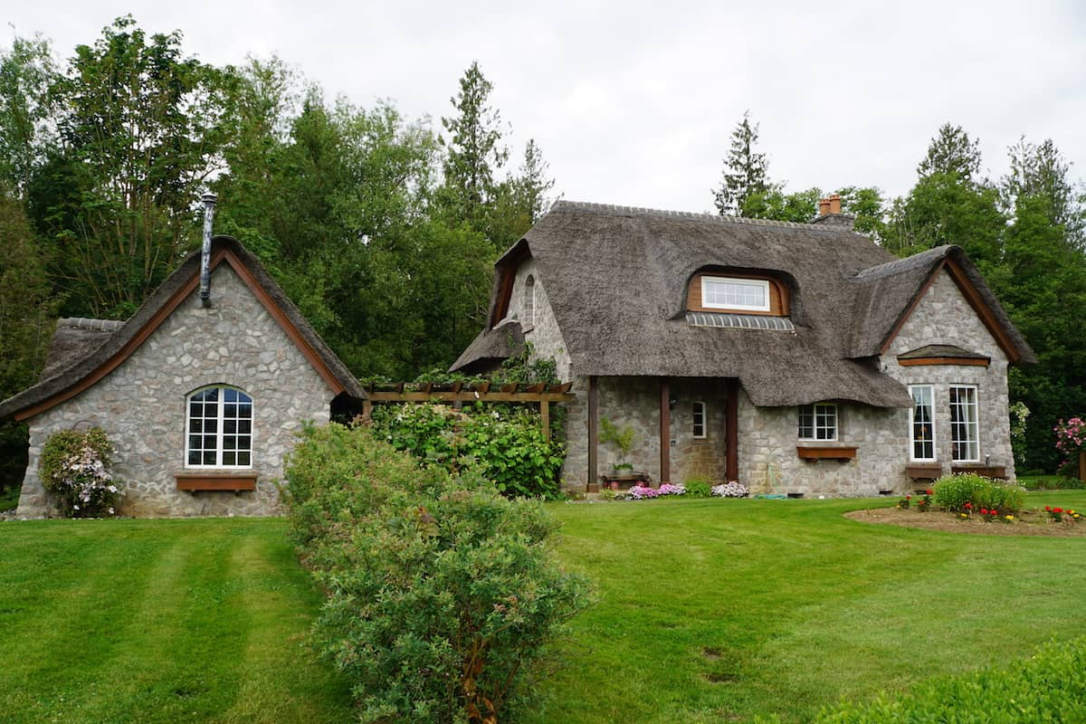 House with thatched roof. One of the best things to do in Lynden if you want to be active is to walk, hike, jog or bike Jim Kaemingk Sr Trail. #storybrookhouse #thingstodoinLynden #washington