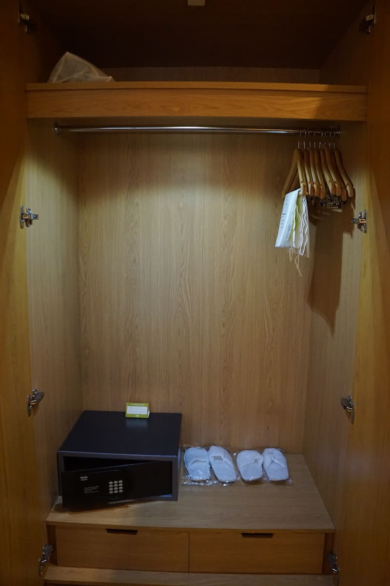 hotel suite closet with safe
