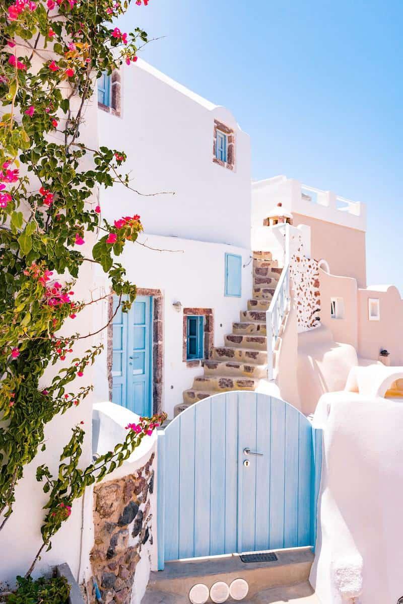 closed blue gate photo oia greece