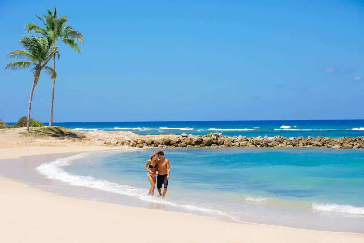 romantic couple on white sand beach