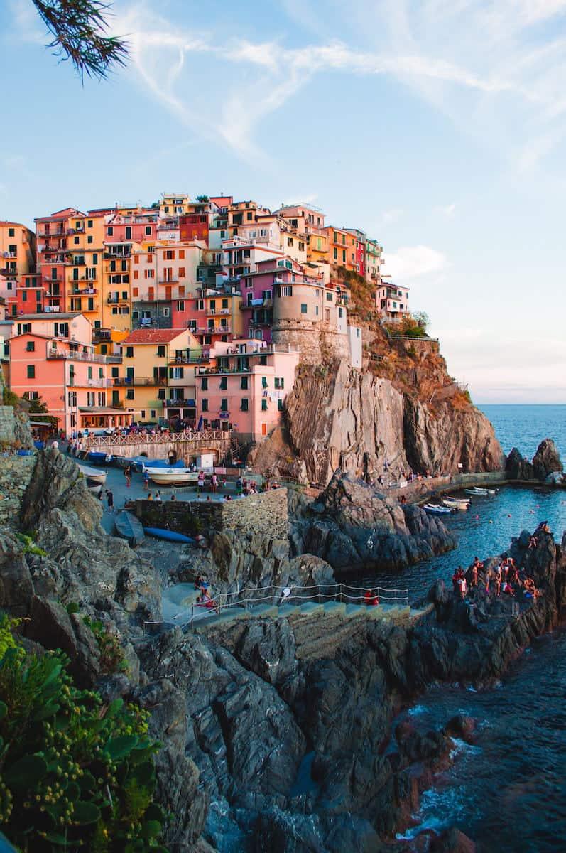 colorful homes on Italian hillside overlooking the ocean