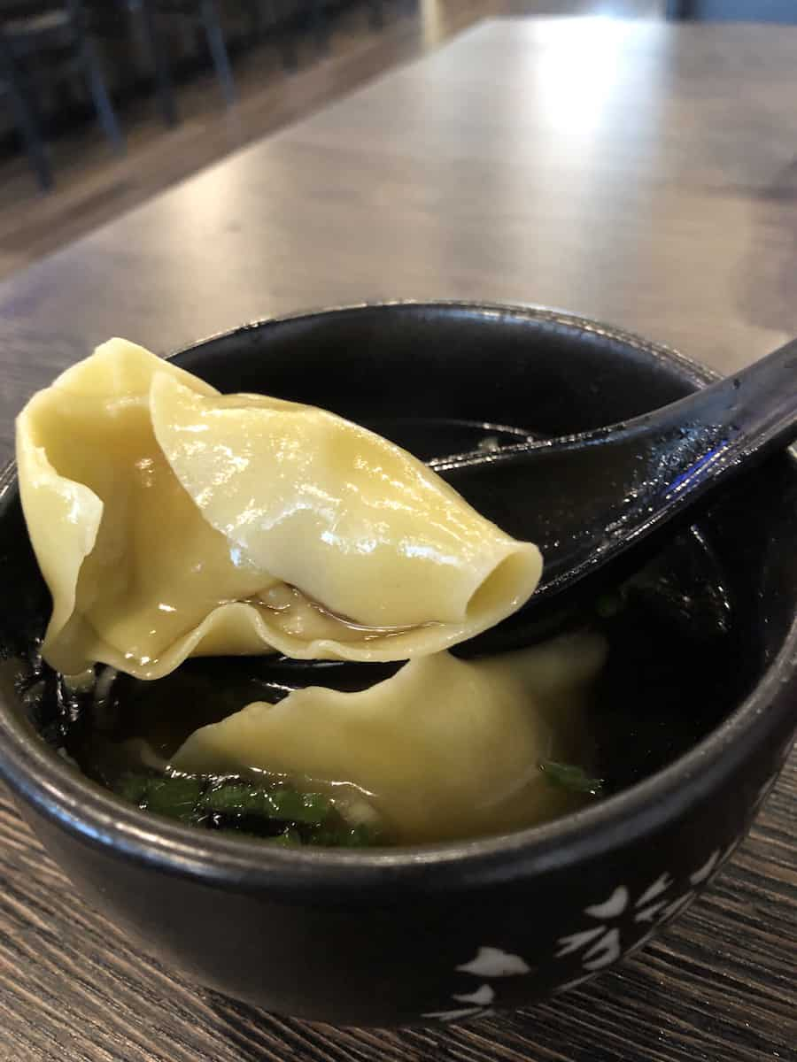 black bowl with two soup dumplings