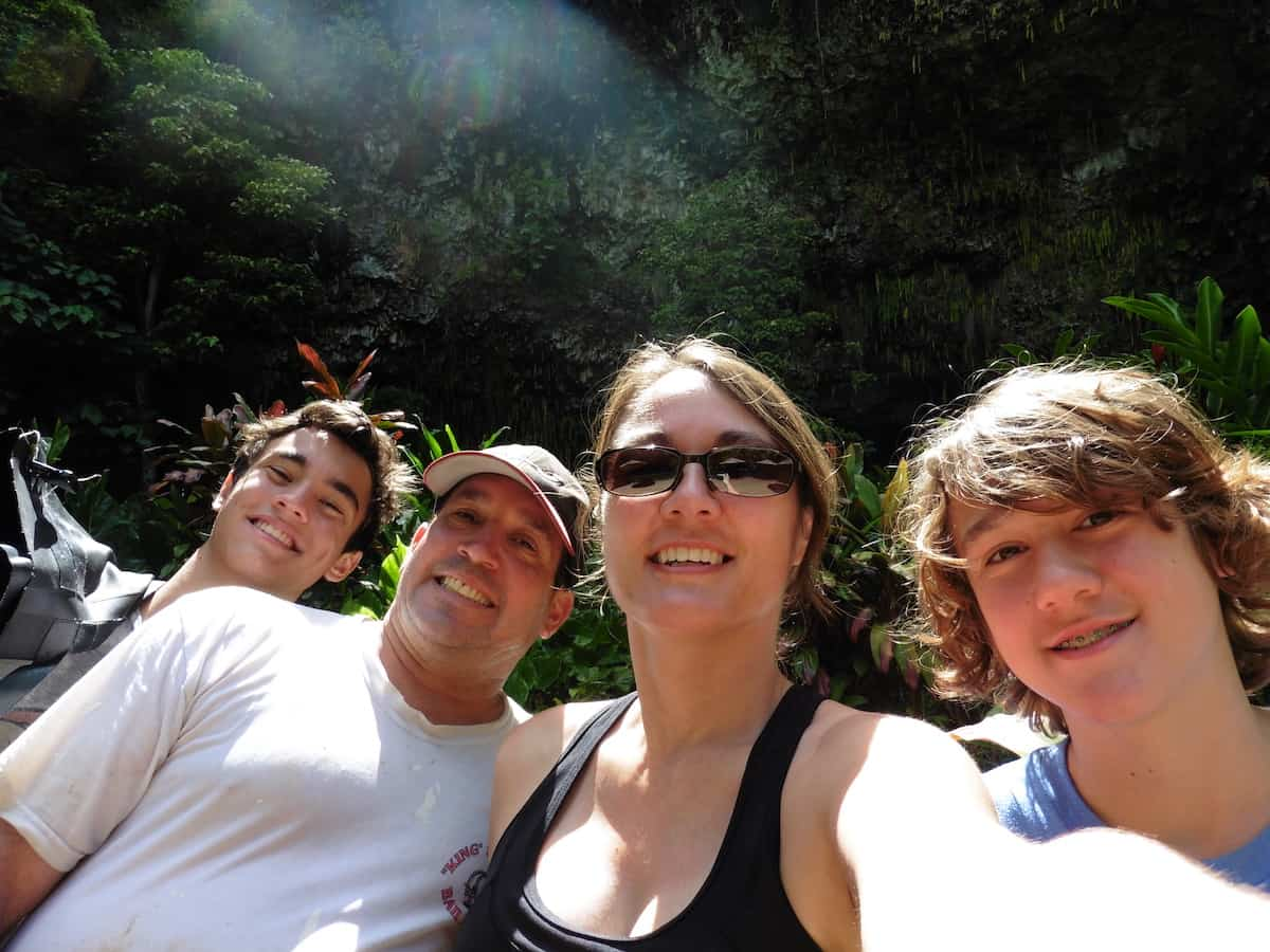 happy family in kauai after kayaking to waterfalls