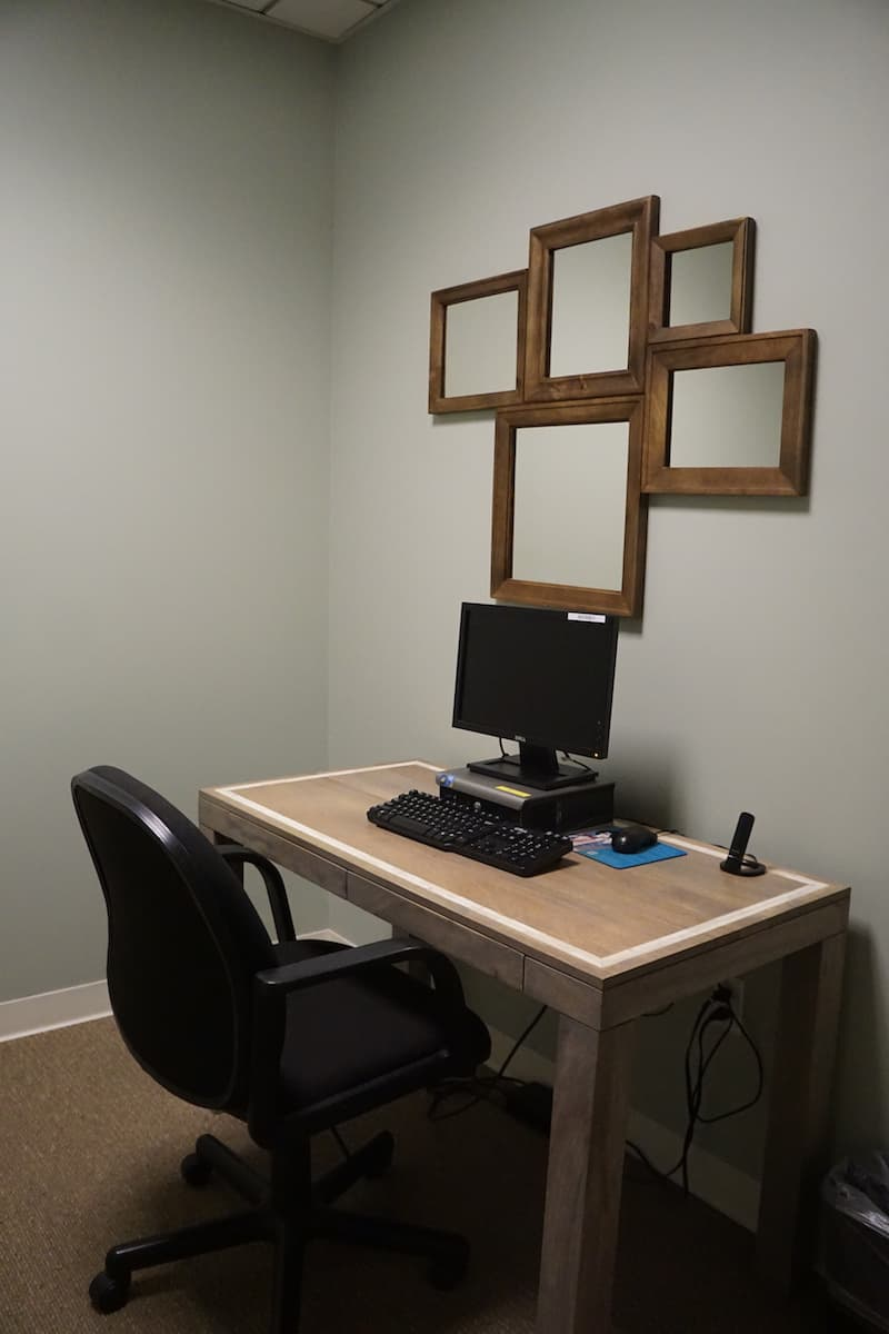 room in access suite lounge with desk with computer and chair