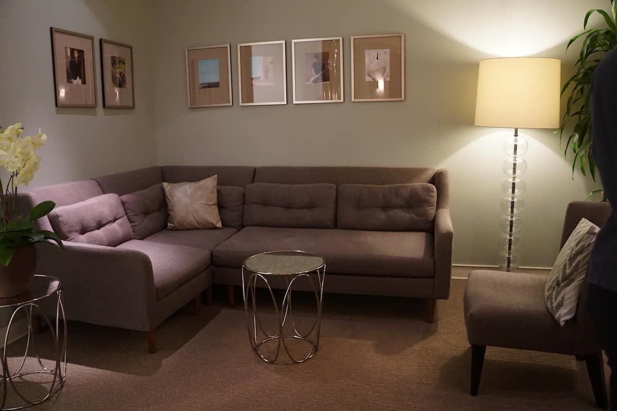 large soft purple sectional couch and chair at access suite lounge
