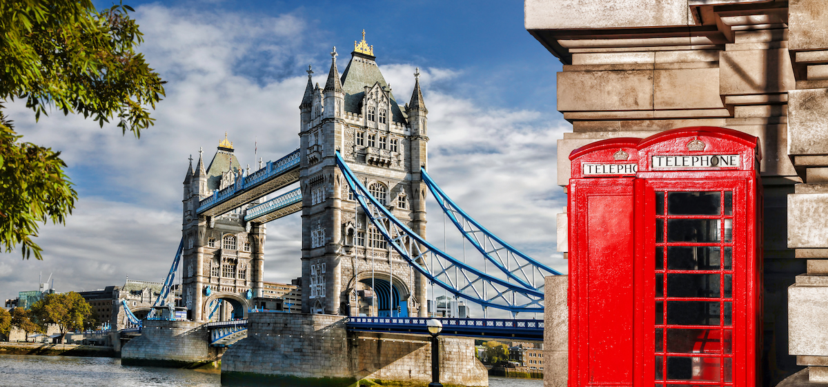 Tower Bridge with red phone booths in London, UK. $23,000 ten day trip to Europe for $633