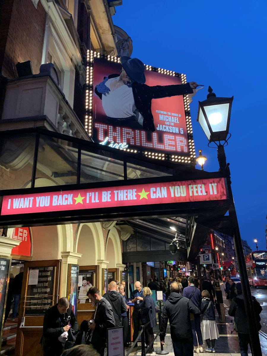 people buying tickets for a theatre show in west end