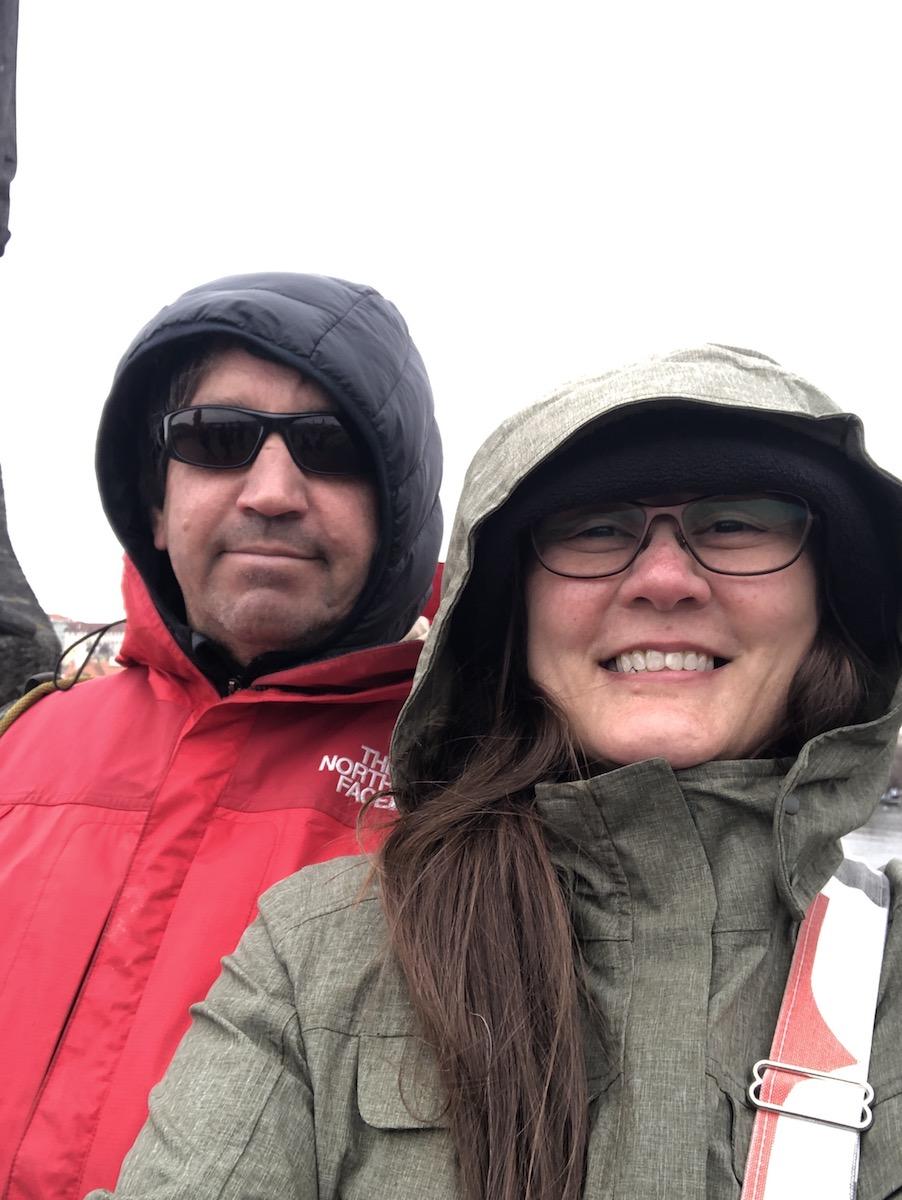 couple bundled in raingear