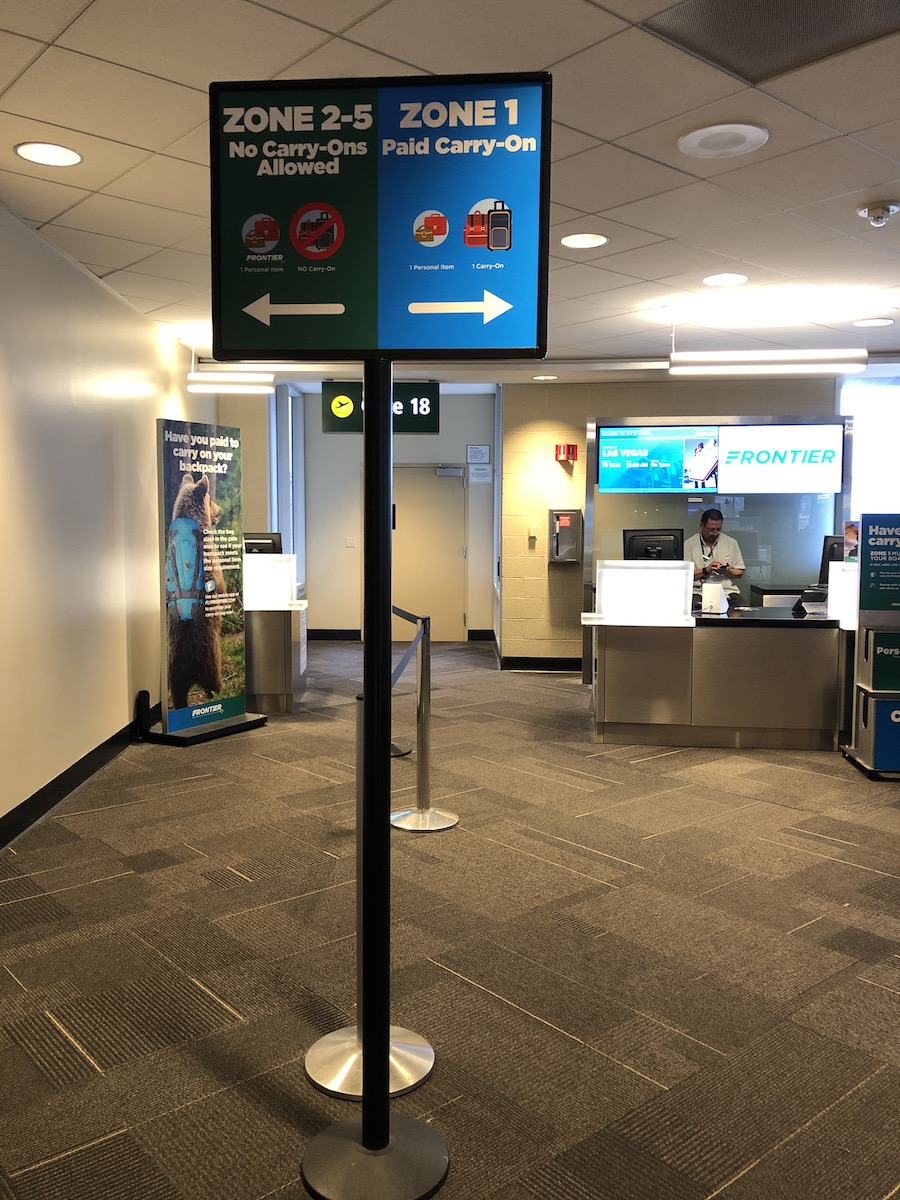 Frontier boarding zone signs at gate at airport