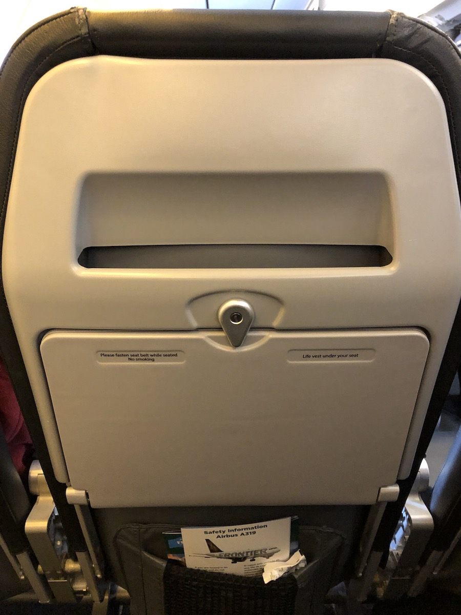 full tray table and magazine slot in seat back of airline seat
