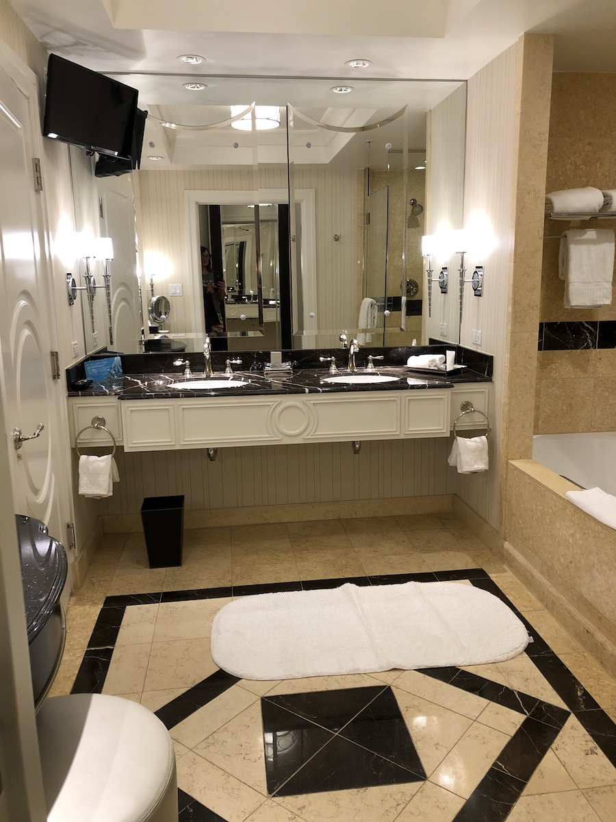 the palazzo las vegas suite bathroom with marble counters and tiled floors