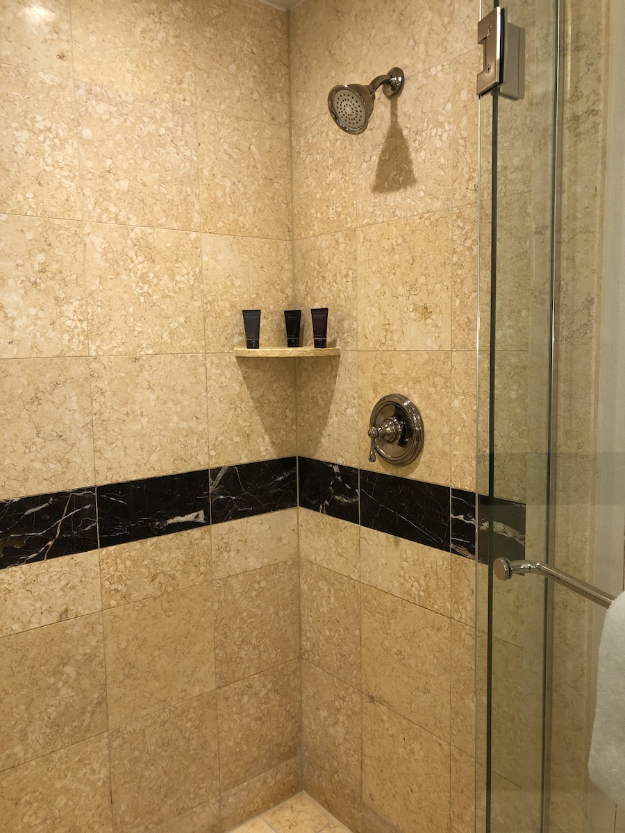 cream colored marble tiled in shower at the palazzo las vegas