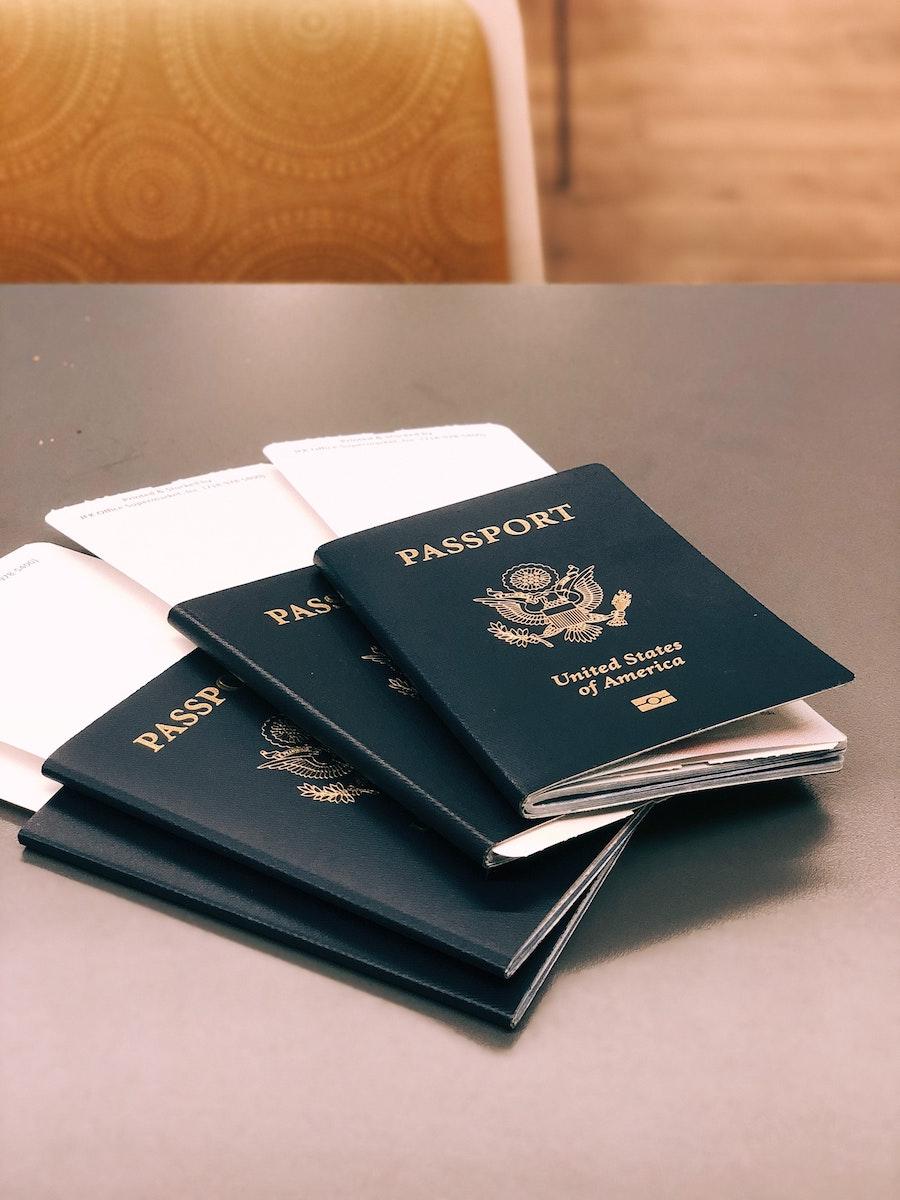 four blue passports, United States passports