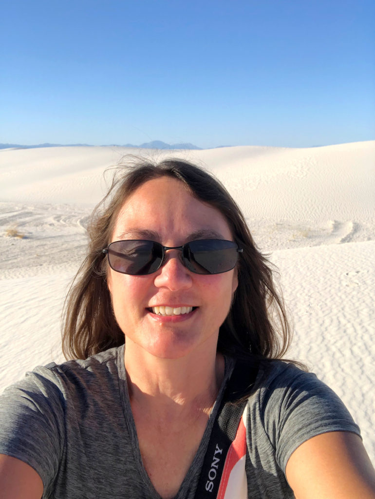 girl standing in white sands dunes at White Sands National Park