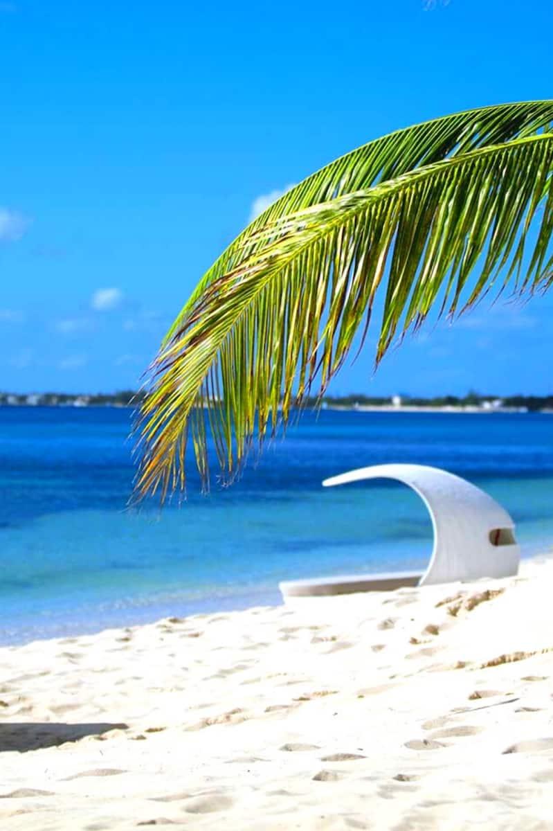 white beach cabana on white sand beach in the Caribbean