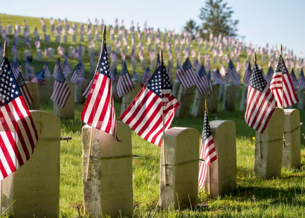 cemetery with flags on gravestones on memorial day, pine grove cemetery, lynn, United states