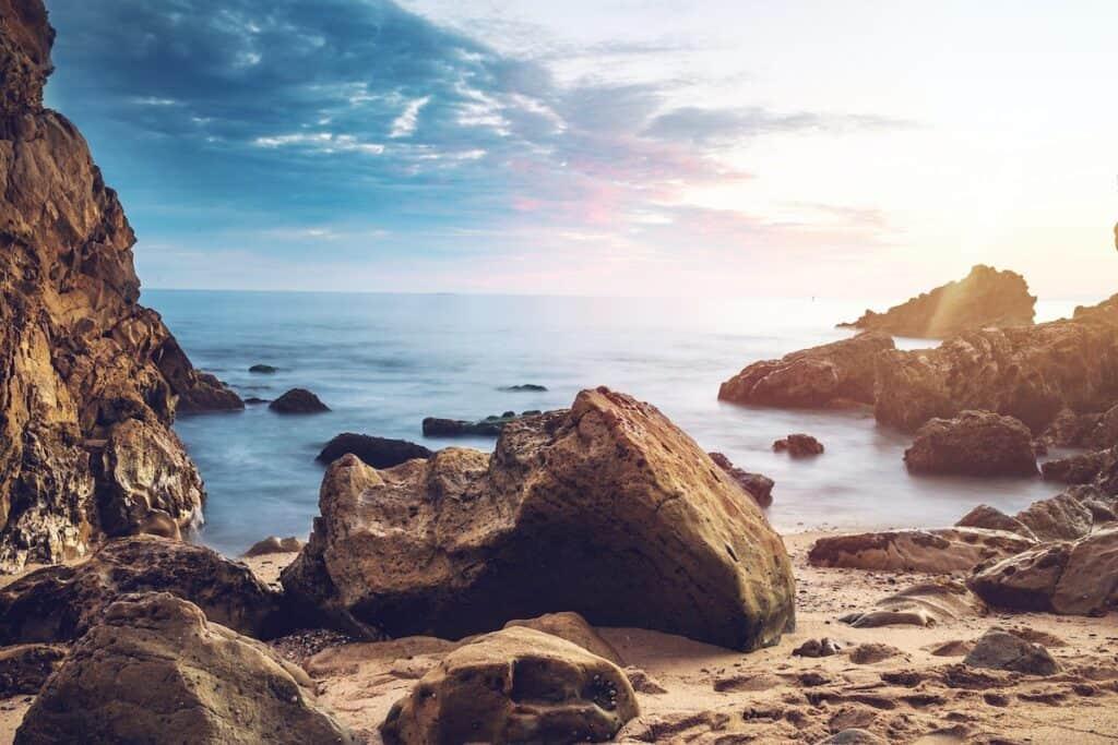 huge rock near beach at Little Corona Beach, Newport Beach, United States