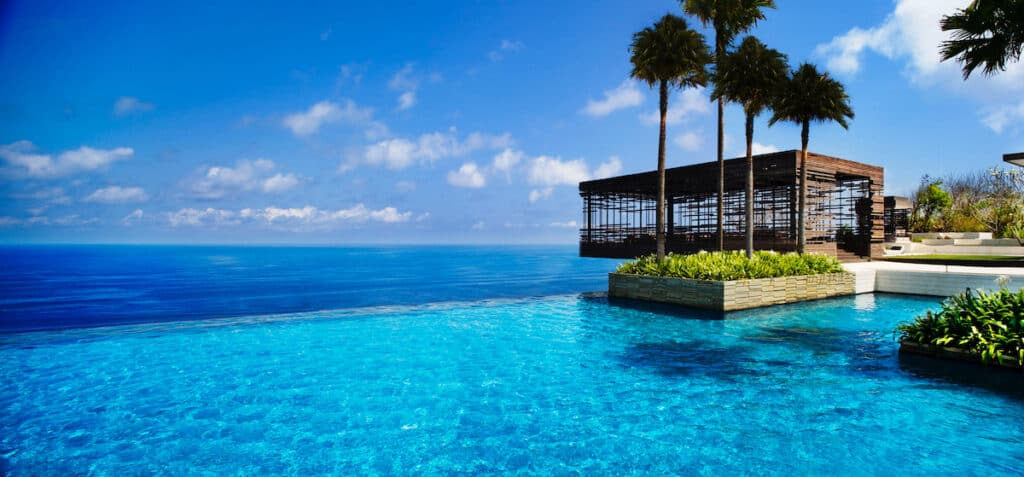 infinity pool at tropical island resort. Alila Villas Uluwatu infinity pool in Bali