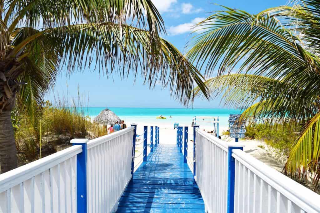 blue and white wooden bridge near beach cayo coco cuba southwest double points