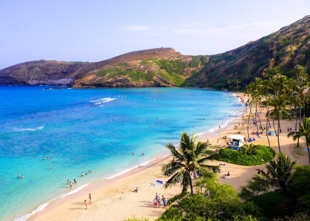 $238 roundtrip flights to Hawaii, aerial photography of people in ocean Hanauma Bay, Hawaii