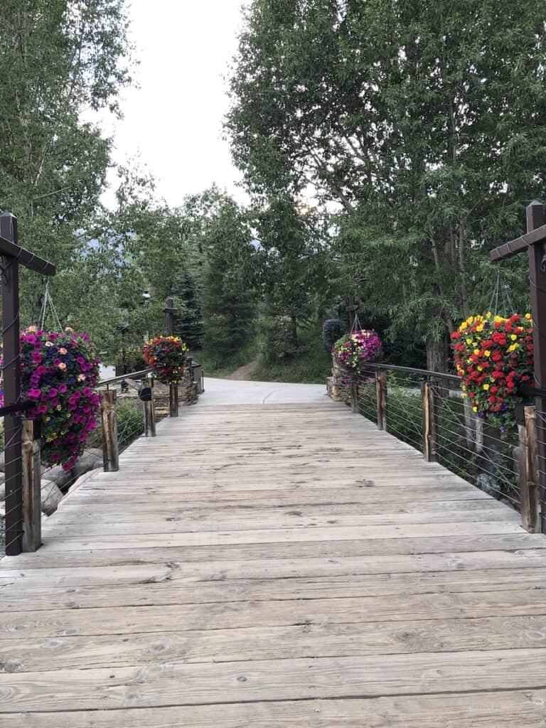 flower lined bridge, Blue River Plaza walking trail Breckenridge, Colorado