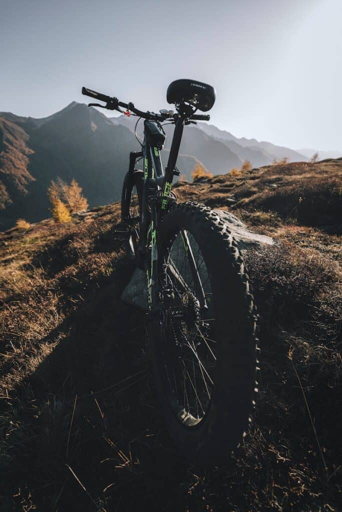 black and green bicycle on mountain