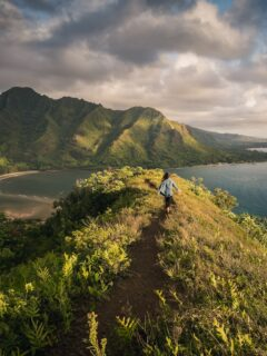 woman standing on a hill in islet in Hawaii