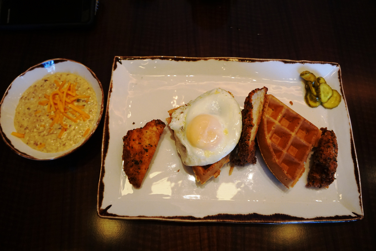 chicken and waffles topped with a fried egg and sausage gravy and pickles at Pechanga Lobby Bar and Grill