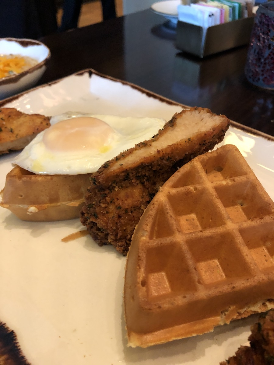 chicken and waffles topped with a fried egg Pechanga Lobby Bar and Grill