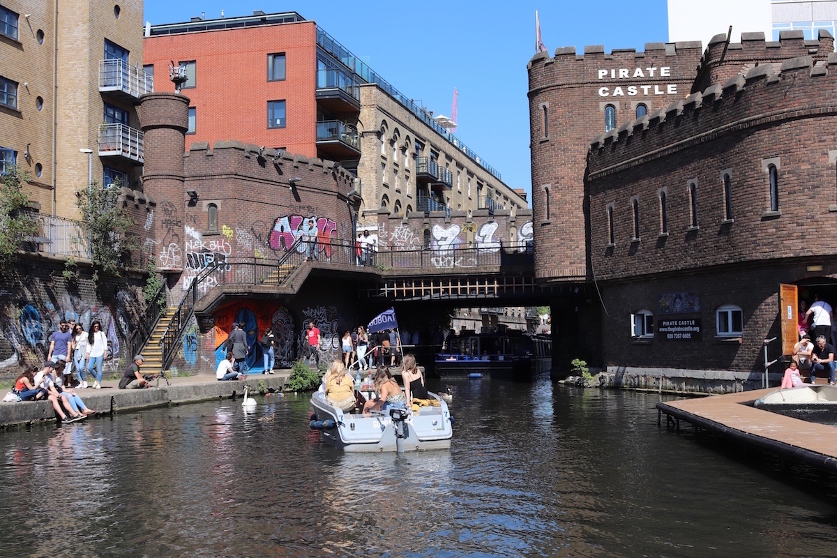 people hanging out at a Camden canal