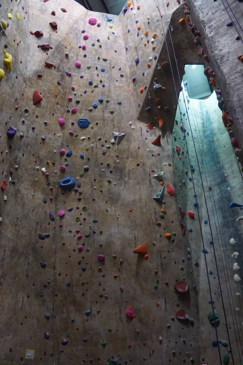 40 foot indoor rock climbing wall with hundreds of colorful hand and foot holds of various sizes